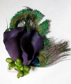 Eggplant purple calla lily with peacock feather hair flower