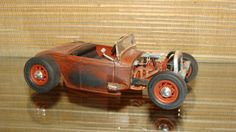 """Flat Head 4 cylinder, slicks, customized dice shifter knob and aluminum floor.  This rat rod is primered, made to look dirty and rusty and ready to go!!  Made from a plastic model kit.  Rat rod is 5 1/2"""" long by 3"""" wide."""