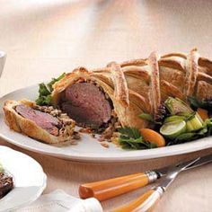 Beef Wellington with Madeira Sauce Recipe -This very impressive-looking yet easy-to-make dish can be made ahead. Just finish the baking process when your guests arrive. —Janaan Cunningham