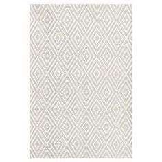 Stylishly anchor your living room or patio ensemble with this lovely indoor/outdoor rug, showcasing a diamond trellis motif in white and platinum hues.    Product: RugConstruction Material: PolypropyleneColor: Platinum and whiteFeatures:  Suitable for indoor or outdoor useReversible Note: Please be aware that actual colors may vary from those shown on your screen. Accent rugs may also not show the entire pattern that the corresponding area rugs have.