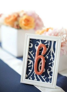 painted table numbers in frames with pretty fabric
