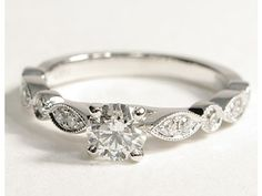 With a princess cut aquamarine center stone maybe... pffft traditionalists.