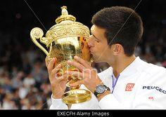 Wimbledon, UK. 12th July, 2015. Novak #Djokovic kisses the winners trophy after winning #Wimbledon tennis championships final © Action Plus Sports/Alamy Live News