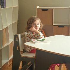 Adorable little girl with modern grey kids table and chairs by Sprout. Perfect for any kids bedroom, play room, or nursery.