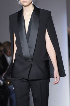 6. Victoria Beckham Fall 2013 RTW Tuxedo Cape- It resembles the huke as it is closed over the shoulders and kind of but not completely opens at the sides.