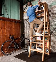 Smart Bookcase Features a Ladder That Pulls Out Immediately