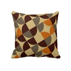 A classy retro pattern shades of orange. brown and cream, looks fabulous on these quality throw pillows, in neutral colours which will blend in anywhere