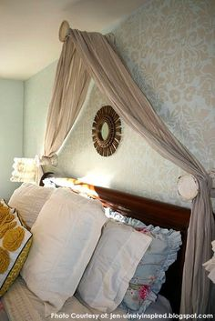 Bed drape and damask walls…