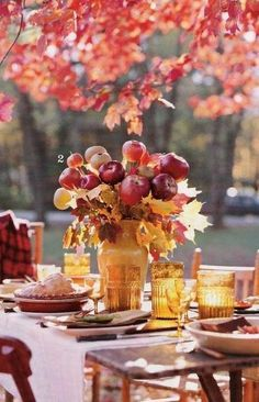 Gorgeous apple centerpiece and autumn leaves