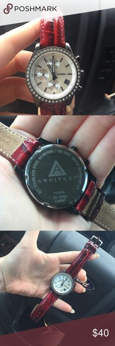 RARE Fossil Arkitekt watch Features a red croc embossed/patent leather band, a crystal bezel, mother of pearl face, and gunmetal hardware. Watch does not tick, I assume it just needs a battery. Stainless steel. Water resistant for 50m/165 ft. Style # ES-1649 Fossil Accessories Watches