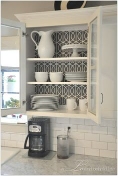a LO and behold life: Operation Kitchen Cabinet Re-org - love the idea of adding fabric to the back of the cabinet for a pop