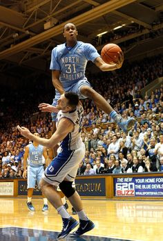 John Henson Photos - John Henson of the North Carolina Tar Heels jumps over Miles Plumlee of the Duke Blue Devils as he drives to the basket during their game at Cameron Indoor Stadium on March 2012 in Durham, North Carolina. - North Carolina v Duke Carolina Pride, Carolina Blue, Carolina Girls, Tar Heels, John Henson, Unc Chapel Hill, Unc Tarheels, University Of North Carolina, Look Here