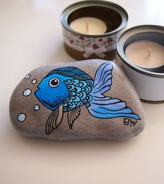 Hand painted beach pebble paperweight stone interior decoration blue turquoise violet fish