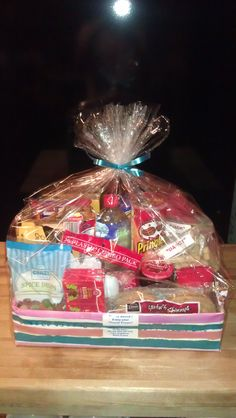 This basket was made for friends who are moving. It is full of goodies for them & their 2 dogs to snack on while they are on the road.  Basket includes: peanut butter, jelly, sandwich skinny's, napkins, plates, plastic silverware, potato chips, bottled flavored water, pudding cups, raisins, crackers, licorice, cracker jack, spice drops, cheese & cracker tray, dog biscuits.