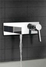 Minimal slope concrete ramp sink with negative edge slot for Ultra modern bathroom fixtures