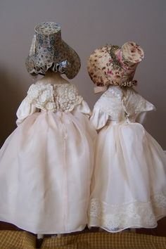 Two amazing milliner's models in period clothing. What magnificent chapeaux!