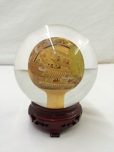 Vintage glass globe with painting and etching inside