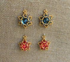 """I made these earrings using Sidonia's """"Sunset Glare"""" pattern. The top pair is made with 14mm rivolis, as the pattern calls for. I wondered if I could adapt the pattern to work with 12mm rivolis. And I could! The Indian Pink earrings use 12mm rivolis. This is a wonderful pattern! I know I will be making lots of these. Thank you, Sidonia!"""