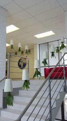 Upside down Boskke Sky planters recently installed with Aglaonema plants above a staircase to bring greenery into an area that normally has no space for plants.