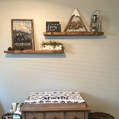 Cute floating shelving in a baby's room. Nursery Décor Ledge Shelving Storage Mountain Theme Baby Room Boy Room Girl Room Outdoor Theme Nursery Adventure Awaits