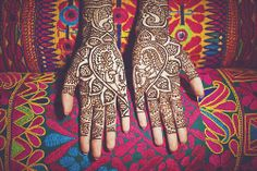i love mehendi showing the bride and groom exchanging garlands