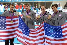 USA relay team members from left Michael Phelps, Conor Dwyer, Ryan Lochte and Ricky Berens pose with their gold medals and American flags after winning the men's 4x200m freestyle relay finals during the London 2012 Olympic Games at Aquatics Centre. (Kirby Lee-USA TODAY Sports)