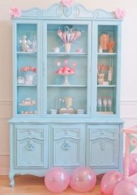 Unique Dessert Display - Clear out a hutch or bookcase, and serve a different dessert on each shelf. Right. because i just happen to have a tiffany blue painted antique hutch in my garage, waiting for me to bake deserts for display, sitting around in my garage for when I have time to plan a huge desert party...