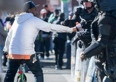 Here's a look at the side of the Baltimore protests you probably haven't seen.  A man fist bumps law enforcement personnel.