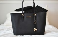 Fashion And Cheap Michael Kors Jet Set Saffiano Travel Medium Black Totes Is Loved By More And More People! #NYFW #giftsforher | See more about michael kors jet, kors jet set and michael kors.