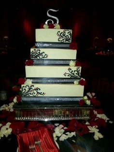 custom wedding cake by The Sweeter side of Chantrelles at Padua Hills Theatre Square black and red wedding cake