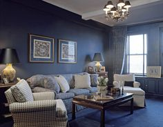 "Delft Blue Living Room FINE PAINTS OF EUROPE DELFT BLUE 4003: ""I used this deep Mediterranean blue all over this room — on the walls, on the moldings, on the cabinets, even on the floor, with a carpet in the same tone. By using it so completely, it makes the different planes all blend into each other. The color unifies the space and blows out the boundaries. You're swept away by the blue and have no sense of the size of the room."" -John Barman"