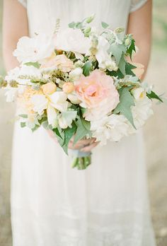 """Brides.com: Floral Inspiration for a Spring Wedding. A Romantic White-and-Blush Wedding Bouquet. """"This is perfect for a romantic wedding in a garden,"""" says Juliet Totten of Poppies & Posies, who created this fresh, feminine bouquet for a wedding at a private residence, using different varieties of garden roses, andromedas, and tree peonies—all sourced from the bride's mother's garden, no less! The result was a gorgeous, loose composition of blooms in ballerina colors. The bouquet's organic…"""