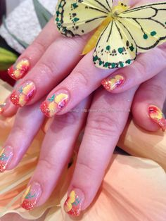 Another example of orange & yellow 1 / one stroke nail art flowers over a French manicure except the tips are orange glitter polish. Free hand. Floral Nail Art