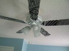 DIY: dont buy a new fan just re do the one you have. Paint, cover blades with wall paper, scrap paper, tissue paper, paint... match your new decor. Neat and crafty idea ;)