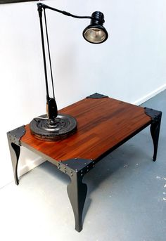 Coffee table- love the mixing of wood and iron here! Visit stonecountyironworks.com for more amazing wrought iron designs!