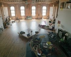 Maybe you could rent a big weird-looking warehouse and make it fabulous, like this.