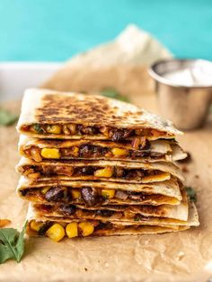 These Hearty Black Bean Quesadillas are an easy vegetarian snack or light meal that are filling, flavorful, and freezer-friendly! BudgetBytes.com