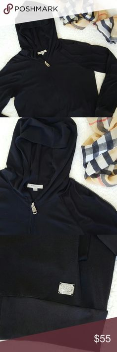 Burberry Black Sport Hoodie Autentic Burberry women black sport zipped hoodie.  Perfect condition it only has a very small hole in one of the front pockets as shows in the pictures.  Size Large (European) Missing labels.  Made of two diferente fabrics cottonfor the body  and acrylic for sleeves . Measurements  Armpit to armpit 19 1/2 in Length 26 in Sleeve 22 in Burberry Tops Sweatshirts & Hoodies