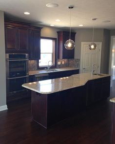 Kitchens & Baths | Photo Gallery | 3 Pillar Homes #3PillarHomes #Kitchen #Island #Oversized #Lighting #Sound #System #Cabinets #Cabinetry #Counters #Countertops #Granite #Hardwood #Flooring #Oven #Microwave #Pantry #Luxury #Home #Design