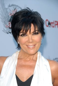 summer short haircut for women over 50: dark pixie with fringe