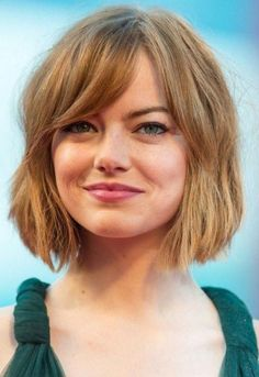 Emma stone with a copper colored shaggy bob, and side bangs, wearing a top short bob hairstyles Shaggy Bob Hairstyles, Short Haircuts With Bangs, Asymmetrical Bob Haircuts, Bob Haircut With Bangs, Bob Hairstyles For Fine Hair, Undercut Hairstyles, Short Hair Cuts, Short Hair Styles, Emma Stone Hairstyles