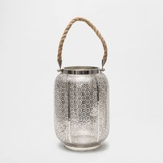METAL LANTERN WITH A JUTE HANDLE