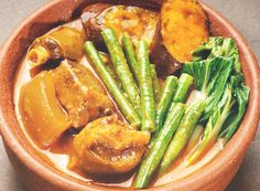 This Filipino Kare-Kare Recipe is a meat and vegetable stew with oxtail, beef or tripe, eggplant, banana buds, pechay, string beans and other vegetables.