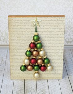 I used miniature glass ball ornaments to create a Christmas tree to decorate my home with this winter. Easy to make decor! #xmastreedecorations