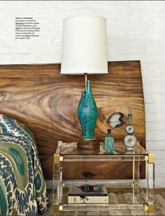 suzani bedding, wood headboard, gold and lucite table