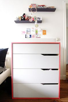 In the #nursery: Washi tape adds a pop of color to a plain Ikea Mandal dresser #DIY #baby #nursery #fluo