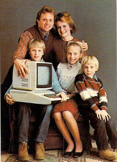 """Family Computing. ...""""Dad, I've lost the feeling in my legs..,can you lift this this giant box off my lap please?"""""""