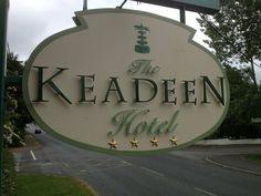 Signs in Kildare. This is raised letters on timber frame with hoppin' gold stars and a hand painted topiary on top