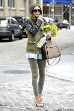 Olivia Palermo. Love the olive green legging jeans, pointy toe pumps, mixed texture jacket and the bronze handbag!