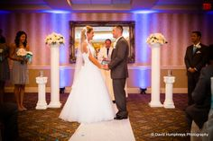 We love this photo of our bride and groom exchanging vows at the Sterling Ballroom, Tinton Falls, NJ. www.SterlingBallroomEvents.com Photo courtesy of David Humphreys Photography. #NJWeddings #Wedding #bride #groom #SterlingBallroomNJ #SterlingBallroom #CentralNJWeddings #TintonFalls #DoubleTree #NJBanquetHall #Venue #WeddingVenue #NJWeddingVenue